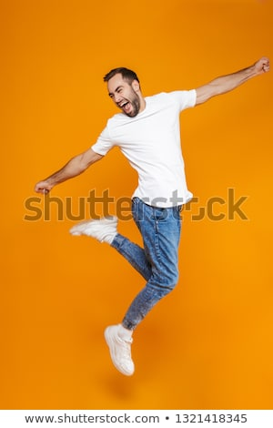 Full length portrait of a smiling bearded guy Stock photo © deandrobot