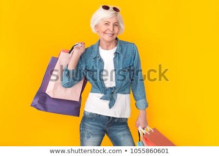 Idős nő bevásárlótáskák boldog idős nő mutat Stock fotó © FreeProd