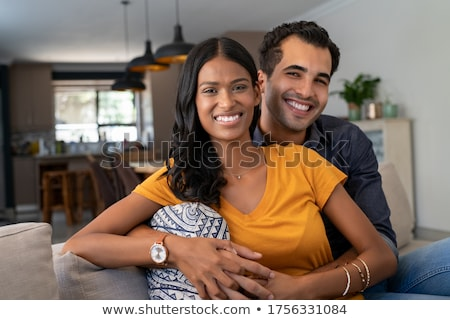 A Middle Eastern couple cuddling Stock photo © monkey_business