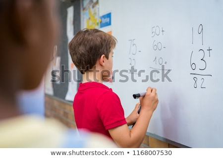 Boy solving sums Stock photo © IS2