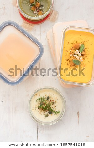 Foto stock: Pumpkin Soup In Glass Jar On Cutting Board