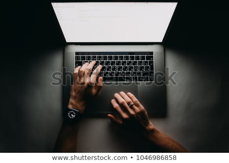 man with smartwatch and computer at night office Stock photo © dolgachov