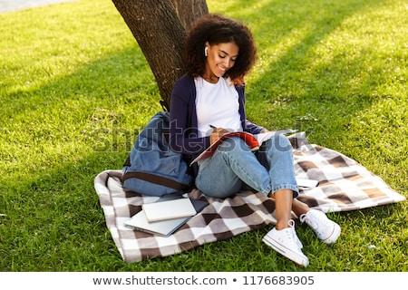 Nő ül kint park ír jegyzetek Stock fotó © deandrobot