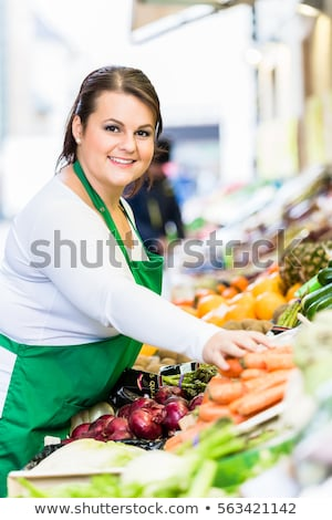 Saleswoman with fruit and vegetables at famers market  Stock photo © Kzenon