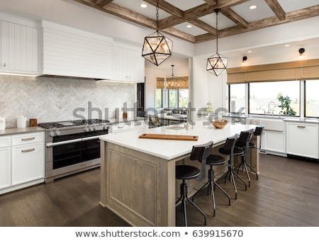 Kitchen Interior with Island, Sink, Cabinets, and Hardwood Floors Stock photo © ruslanshramko