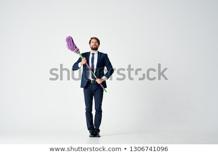 young handsome businessman with mop isolated on white stock photo © elnur