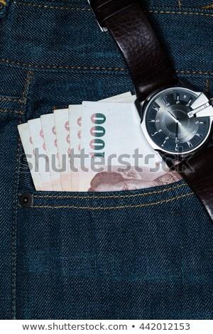 Visa card with dollar cash in blue jeans pocket Stock photo © vapi