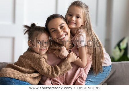 Childhood, love, happiness and family bonds. Indoor portrait of beautiful cute children sisters and  Stock photo © Lopolo