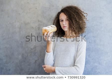 治す 巻き毛 少女 食べ クロワッサン 壁 ストックフォト © boggy