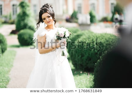 beautiful girl in purple dress with lilac flowers Stock photo © svetography