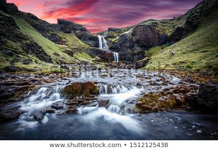 Nascer do sol Islândia sol nebuloso manhã Foto stock © Kotenko
