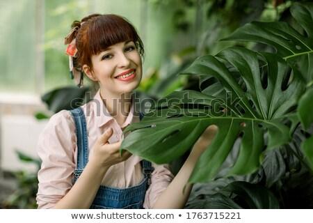 Mujer jardinero agua pueden pie Foto stock © deandrobot