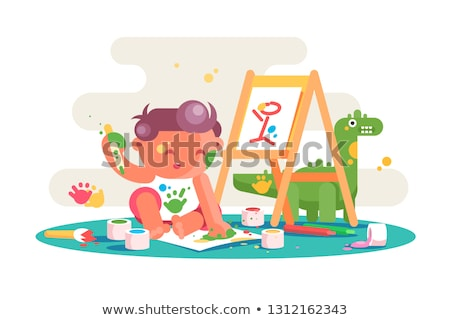little kid painting picture on easel stock photo © jossdiim