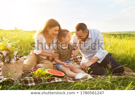 Portrait of happy father and her daughter with fruits Stock photo © Kzenon