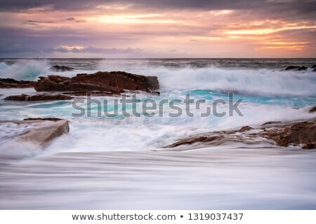 rock pool overflows in large swells stock photo © lovleah