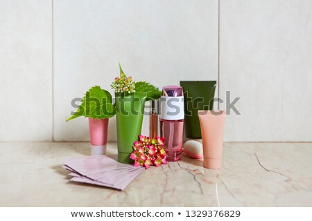Face cream and hydrangea in the bath Stock photo © dashapetrenko