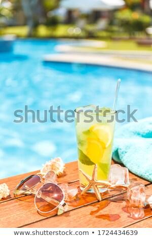 Mojito cocktail on the table outdoors. Concept of luxury vacatio Stock photo © dashapetrenko