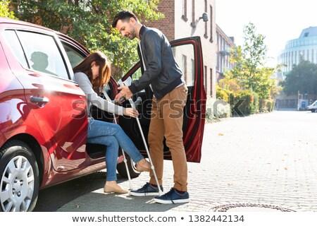 муж помогают инвалидов жена внутри автомобилей Сток-фото © AndreyPopov