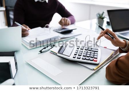 Kettő üzletemberek számla számológép oldalnézet asztal Stock fotó © AndreyPopov