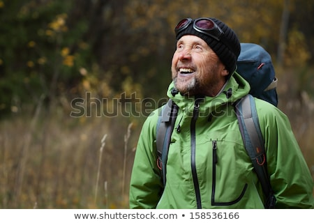 close up of man outdoors walking in autumn landscape stock photo © monkey_business