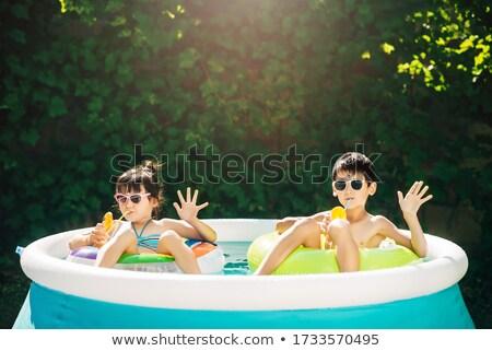 笑みを浮かべて · 少年 · 女の子 · スイミングプール · アクアパーク · 水 - ストックフォト © kzenon