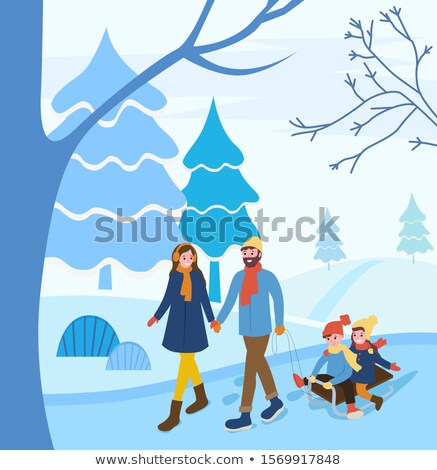Stock photo: Woman Holding Sledge In Snowy Landscape