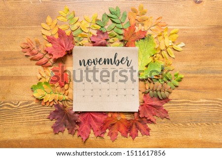 November calendar sheet surrounded by autumn leaves of various colors Stock photo © pressmaster