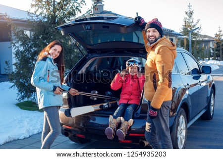 Young woman with ski equipment spending winter vacation at mount Stock photo © boggy