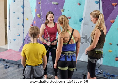 Young climbing instructor consulting group of active young people Stock photo © pressmaster