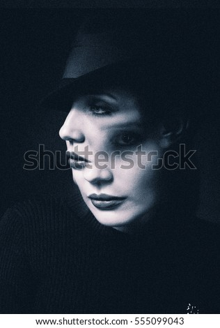 Beautiful young woman and two men in mysterious black mask sitti Stock photo © GVS