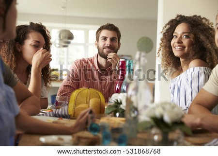 Surface level view of a group of multi-ethnic friends interacting with each others in camper van at  Stock photo © wavebreak_media