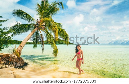 Beautiful bikini model on Tahiti luxury travel vacation island posing in red swimwear relaxing on sa Stock photo © Maridav