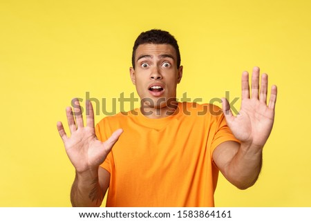 Man become victim feeling scared, panicking, raise hands in surrender, trying calm someone telling d Stock photo © benzoix