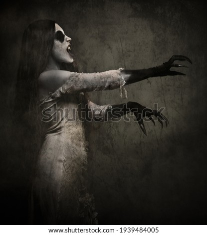Dracula Girl With Long Fingers Stock photo © stuartmiles