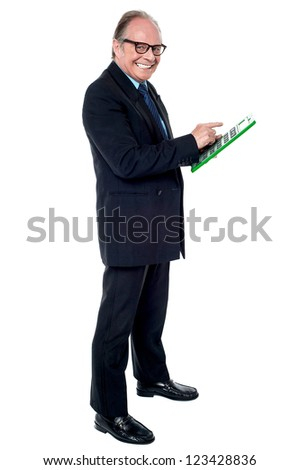 Cheerful senior businessman using a calculator stock photo © stockyimages