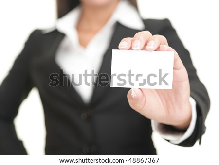 Portrait of a woman showing a blank business card with the camera focus on the object Stock photo © wavebreak_media