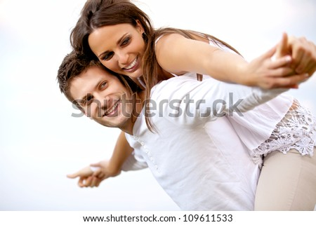 portrait of a couple having fun together against a white background stock photo © wavebreak_media