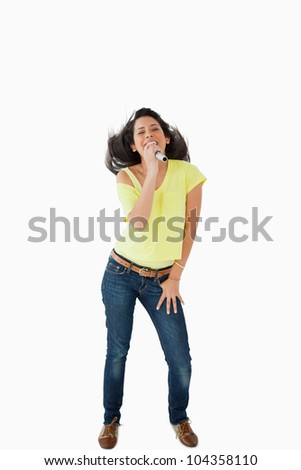 Young Latino woman singing while shaking her head against white background Stock photo © wavebreak_media