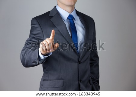 hand of business man pushing a button on a touch screen interfac Stock photo © Suriyaphoto