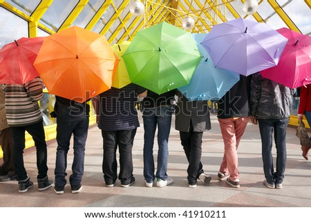 Seven teens with opened umbrellas in pedestrian overpass. rainbow concept Stock photo © Paha_L