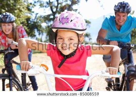 famiglia · tre · persone · biciclette · paese · mamma - foto d'archivio © Paha_L