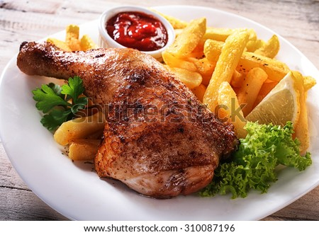 juicy roast chicken with vegetables and ketchup served on porcelain plate on a tablecloth fried ch stock photo © mcherevan