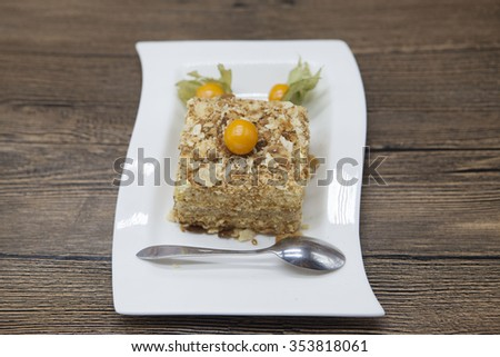 Dukan Diet. Fresh delicious diet cake at Dukan Diet on a porcelain plate with a spoon on a wooden ba Stock photo © mcherevan