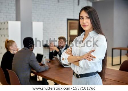 Happy pretty casual brunette cheering in front of camera Stock photo © wavebreak_media