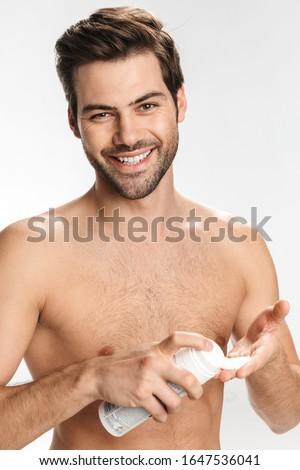 Sonriendo hombre guapo barba pie hamburguesa Foto stock © deandrobot
