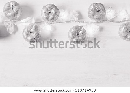 Zdjęcia stock: Christmas Silver Apples Decoration And Lights Burning On A White Wooden Background
