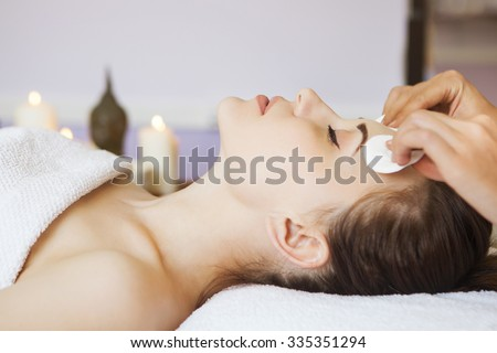 Relaxed woman with a deep cleansing nourishing face mask applied Stock photo © Yatsenko