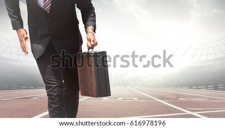 business man lower body with briefcase on track against blurry skyline stock photo © wavebreak_media