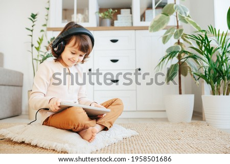 Parents watch baby, living carpet floor Stock photo © IS2