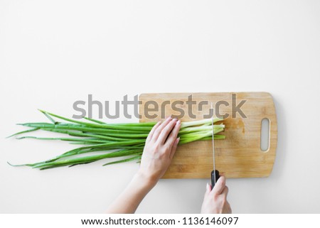 Fresh organic parsley with knife on wooden cutting board. Macro with shallow dof stock photo © Virgin